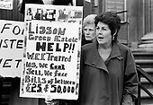 Pat Ryan, joint chair of Lisson Green Estate leaseholders group, demonstrates outside the District Auditor's preliminary hearing into Westminster City Council gerrymandering allegations, Marylebone Council House, 1994.