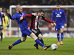 John Fleck of Sheffield Utd challenged by Aron Gunnarsson of Cardiff City during the Championship match at Bramall Lane Stadium, Sheffield. Picture date 02nd April, 2018. Picture credit should read: Simon Bellis/Sportimage