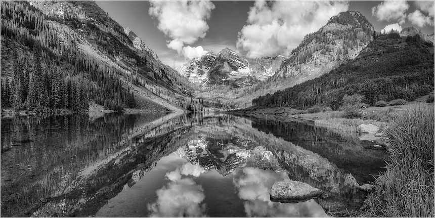 After an early morning of landscape photography at Crater Lake under the shadow of the iconic Maroon Bells, I made my way back down Maroon Creek, eventually ending up where everyone takes their pictures of the lake and both Maroon and North Maroon Peaks in the distance. And I had to take part, too, especially because skies were just about perfect for a summer morning, and the reflections were like glass.<br />