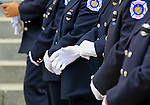 Firefighters don white gloves before the start of the funeral for Manasquan volunteer firefighter Dan McCann. McCann, a firefighter EMT with more than 25 years experience, died last week after a fire department training exercise.  9/21/16  (Andrew Mills   NJ Advance Media for NJ.com)