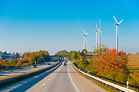 Wind turbines along an autobahn (highway) near Leipzig, Saxony, Germany