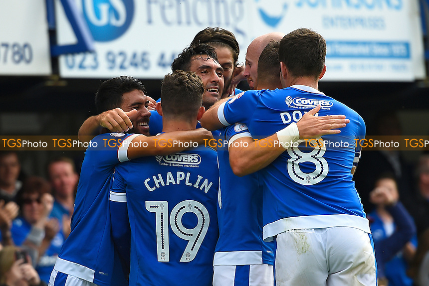 Gary Roberts of Portsmouth middle is mobbed by team mates after scoring the second goal during Portsmouth vs Colchester United, EFL League 2 Football at Fratton Park on 20th August 2016