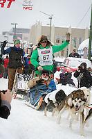Ryan Redington leaves the 2011 Iditarod ceremonial start line in downtown Anchorage, during the 2012 Iditarod..Jim R. Kohl/Iditarodphotos.com