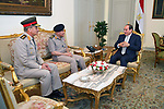 Egyptian President Abdel Fattah al-Sisi meets with his newly appointed Defense Minister General Mohamed Ahmed Zaki and former defense minister Sedki Sobhi after Egypt appointed a new government on Thursday at the Ittihadiya presidential palace in Cairo, Egypt, June 14, 2018. Photo by Egyptian President Office