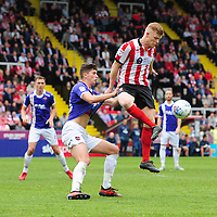 Lincoln City's Elliott Whitehouse shields the ball from Exeter City's Jordan Storey<br /> <br /> Photographer Chris Vaughan/CameraSport<br /> <br /> The EFL Sky Bet League Two Play Off First Leg - Lincoln City v Exeter City - Saturday 12th May 2018 - Sincil Bank - Lincoln<br /> <br /> World Copyright &copy; 2018 CameraSport. All rights reserved. 43 Linden Ave. Countesthorpe. Leicester. England. LE8 5PG - Tel: +44 (0) 116 277 4147 - admin@camerasport.com - www.camerasport.com