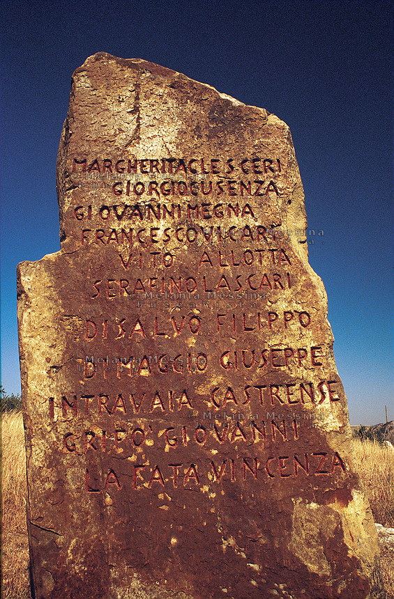 Headstone engraved with the names of the victims of the massacre of Portella della Ginestra, Sicily.<br />
