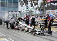 Mar. 10, 2012; Gainesville, FL, USA; NHRA crew members for top fuel dragster driver Shawn Langdon during qualifying for the Gatornationals at Auto Plus Raceway at Gainesville. Mandatory Credit: Mark J. Rebilas-
