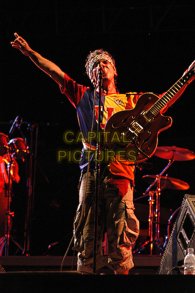 MANU CHAO.Perform live at Park of the Aqueducts, Rome, Italy..July 11th, 2006.Ref: CAV.half length concert gig performance music guitar singing.www.capitalpictures.com.sales@capitalpictures.com.© Capital Pictures.