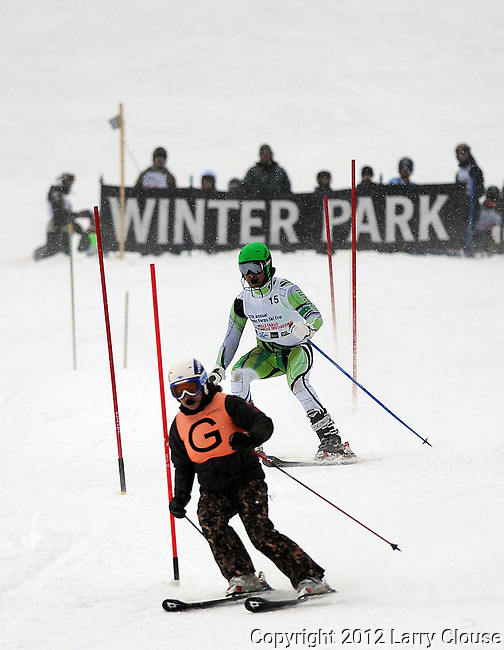March 4, 2012:  Visually impaired skier, Jeff Petersen, follows the commands of his guide as he competes during the World Disabled Ski Invitational Championships, Winter Park, Colorado.