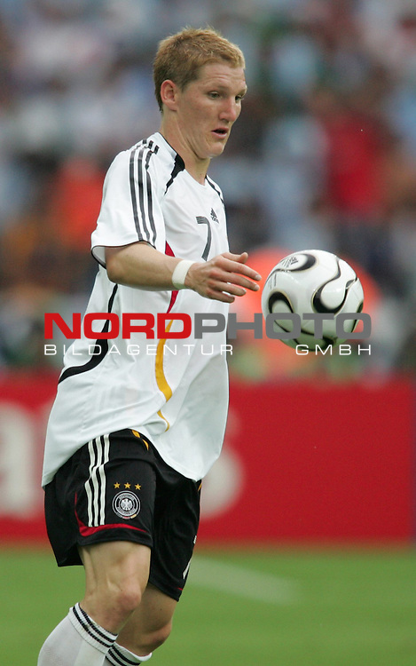 FIFA WM 2006 - Quarter-finals / Viertelfinale<br /> Play #57 (30-Jun) - Germany vs Argentina.<br /> Bastian Schweinsteiger from Germany faces the ball during the match of the World Cup in Berlin.<br /> Foto &copy; nordphoto