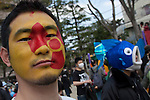 People taking part in The Hangenbatsu Choukyodai Demo which translates at the Anti Nuclear powerplants super huge demo protest against the use of nuclear power. The subject of the dangers of nuclear power generation has become more pressing and popular since the March 11th 2011 earthquake and tsunami damaged the Fukushima Daichi nuclear power plant 200 kms north of Tokyo causing radioactive leaks and bringing the spectre of nuclear contamination to the capital. Organizers said around 7,000 people turned up for the demo that started in Koenji Chou Park and marched around Koenji with punk bands bands leading the good-natured protest as they preformed on a truck at the head of the march. Tokyo, Japan April 10th 2011
