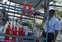 Man selling drinks in the street outside the El Capitolio building, Havana, Cuba.