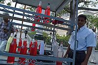 Man selling drinks in the street outside the El Capitolio building, Havana, Cuba.