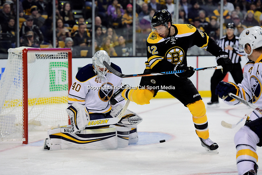 Monday, November 7, 2016: Boston Bruins right wing David Backes (42) jumps out of the way of the puck as Buffalo Sabres goalie Robin Lehner (40) tends net during the National Hockey League game between the Buffalo Sabres and the Boston Bruins held at TD Garden, in Boston, Mass. Boston defeats Buffalo 4-0.  Eric Canha/CSM