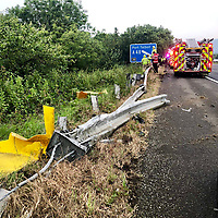 "Pictured: Fire service and police crews attend the scene where a silver car dropped 30ft off the M4 motorway.<br /> Re: A driver came off the M4 motorway before dropping down a 30ft embankment near the Margam Junction in south Wales.<br /> The male driver of the silver car suffered minor injuries despite the car landing on its side between trees and bushes.<br /> South Wales Police tweeted: ""Single vehicle RTC, amazingly driver suffering minor injuries only after dropping off the motorway and down a 30ft embankment.""<br /> Mid and West Wales Fire and Rescue Service crews attended the scene."