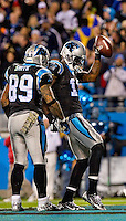 Sports action photography of the Carolina Panthers against the New England Patriots during their NFL game at Bank of America Stadium on November 18, 2013 in Charlotte, North Carolina.  <br /> <br /> Charlotte Photographer - Patrick SchneiderPhoto.com