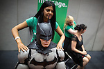 © Joel Goodman - 07973 332324 . 26/07/2015 . Manchester , UK . Batman gets a free massage . Cosplayers inside the venue . Comic Con convention at Manchester Central Convention Centre . Photo credit : Joel Goodman