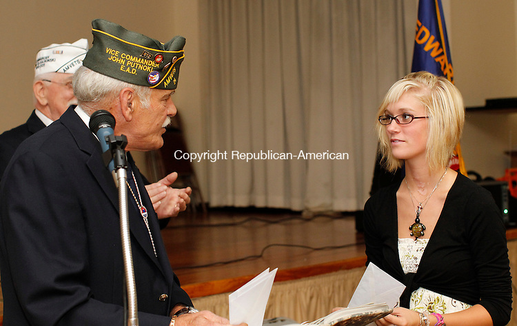 Torrington, CT-14, July 2010-071410CM05  Simone Peet, of Torrington receives the Edward A. Dlugokinski Award Wednesday afternoon at the Knights of Columbus in Torrington.   Presenting the award is John Putnoki, second vice of the AmVet (The American Veterans).  For the first time the AmVet's gave out four scholarships to local students.  Peet is planning on attending nursing school.   --Christopher Massa Republican-American