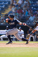 Bryan De La Rosa (26) of the Rome Braves follows through on his swing against the Asheville Tourists at McCormick Field on July 26, 2015 in Asheville, North Carolina.  The Tourists defeated the Braves 16-4.  (Brian Westerholt/Four Seam Images)