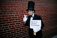 NEW YORK, NY - May 04: An activist disguised as U.S. president Abraham Lincoln takes part in a protest near the USS Intrepid where U.S. president Donald Trump is hosting the visit of Australian Prime Minister Malcolm Turnbull late today after a delay on his schedule on May 4, 2017 in New York City. US President Donald Trump is returning to NYC after taking office in Washington as president,  Photo by VIEWpress/Eduardo MunozAlvarez