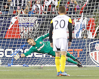 Columbus Crew goalkeeper Matt Lampson (28)  fails to make the save on a penalty kick. In a Major League Soccer (MLS) match, the New England Revolution (blue) defeated Columbus Crew (white), 3-2, at Gillette Stadium on October 19, 2013.