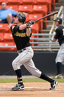 Erik Huber #34 of the West Virginia Power follows through on his swing versus the Hickory Crawdads at L.P. Frans Stadium June 21, 2009 in Hickory, North Carolina. (Photo by Brian Westerholt / Four Seam Images)