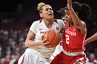 NWA Democrat-Gazette/J.T. WAMPLER Arkansas' Chelsea Dungee drives to the basket while Houston's Octavia Barnes defends Thursday March 21, 2019 at Bud Walton Arena in Fayetteville during the first round of the Women's National Invitational Tournament.