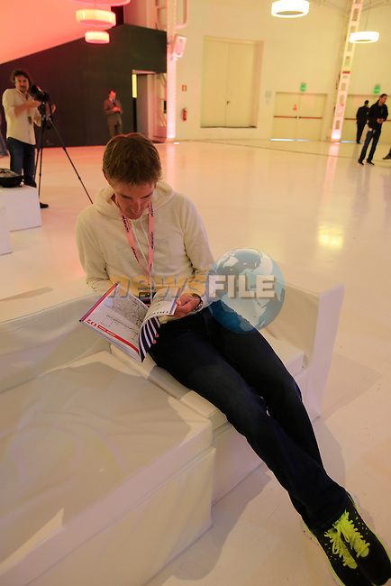 Andy Schleck (LUX) studies next year's stage road book at the 2014 Giro d'Italia Presentation held in the Palazzo del Ghiaccio in Milan, Italy. 7th October 2013.<br /> (Photo: Eoin Clarke/www.newsfile.ie)