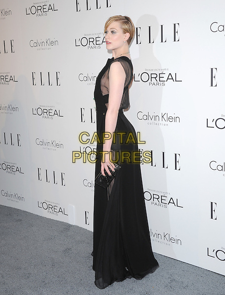 Evan Rachel Wood.18th Annual ELLE Women in Hollywood celebration held at The Four Seasons in Beverly Hills, California, USA..October 17th, 2011.full length black sleeveless necklace sheer dress side clutch bag.CAP/RKE/DVS.©DVS/RockinExposures/Capital Pictures.