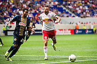 Brandon Barklage (25) of the New York Red Bulls pulls up with an injury. The New York Red Bulls defeated the Philadelphia Union 2-0 during a Major League Soccer (MLS) match at Red Bull Arena in Harrison, NJ, on July 21, 2012.