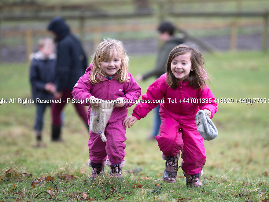 03/04/15<br /> <br /> ***PHOTO ORDER - F.A.O. MATT FEARN***<br /> <br /> L/R: Sisters, Lucy (2) and Matilda (5) Johnson.<br /> <br /> Children brave the rain to take part in a Good Friday  Easter Egg hunt at Chatsworth House in the Derbyshire Peak District.<br /> <br /> All Rights Reserved - F Stop Press.  www.fstoppress.com. Tel: +44 (0)1335 418629 +44(0)7765 242650