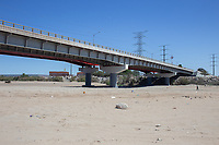 MEXICALI, MEXICO - March 13 . A person  walks on the Colorado River dry riverbank near the US-Mexico Border on March, 13 2019 in Mexicali, Mexico.<br /> The rivers usually end in the sea, the Colorado dies in a border. Its the only case like this in the world. There is less water in the Colorado River, hence less water in crops and areas of northern Mexico.  <br /> (Photo by Luis Boza/VIEWpress)