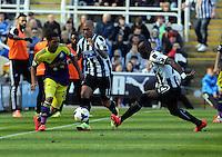 Pictured L-R: Jonathan de Guzman against Yoan Gouffran and Cheik Tiote of Newcastle.  Saturday 19 April 2014<br /> Re: Barclay's Premier League, Newcastle United v Swansea City FC at St James Park, Newcastle, UK.