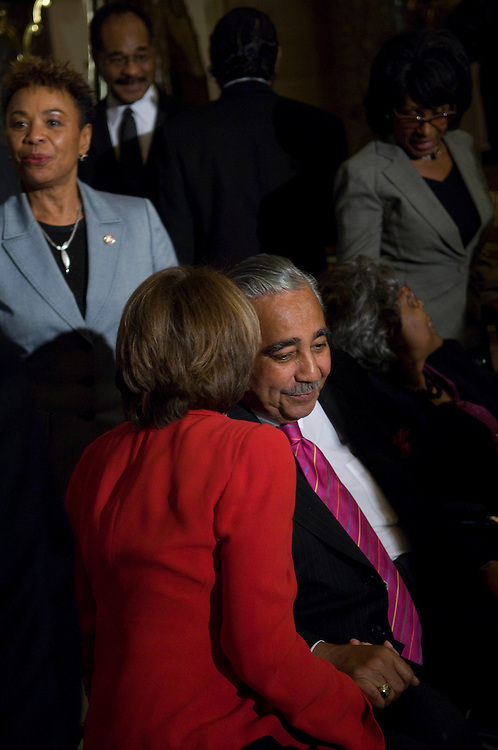 WASHINGTON, DC - Sept. 25: House Speaker Nancy Pelosi, D-Calif., with House Ways and Means Chairman Charles B. Rangel, D-N.Y., during a reception at the U.S. Capitol honoring members of the Congressional Black Caucus. In background are: Rep. Barbara Lee, D-Calif., Rep. Emanuel Cleaver II, D-Mo., Rep. Maxine Waters, D-Calif. (Photo by Scott J. Ferrell/Congressional Quarterly).