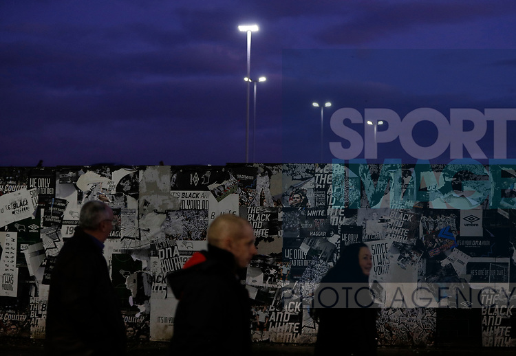 Fans walk past peeling posters on a wall during the FA Cup match at the Pride Park Stadium, Derby. Picture date: 4th February 2020. Picture credit should read: Darren Staples/Sportimage