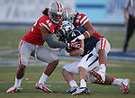 UNLV's Peni Vea (42) and Tau Lotulelei (55) stop Nevada's Kendall Brock (4) during the second half of an NCAA college football game in Reno, Nev., on Saturday, Oct. 26, 2013.<br /> (AP Photo/Cathleen Allison)