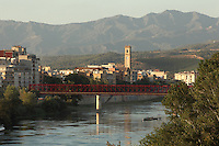 View of the town of Tortosa, with the former railways bridge (antiguo puente del Ferrocarril) over the river Ebro, the tower of the Parroquia del Rosario (Rosary church) and mountains in the distance, Tortosa, Tarragona, Spain. Picture by Manuel Cohen