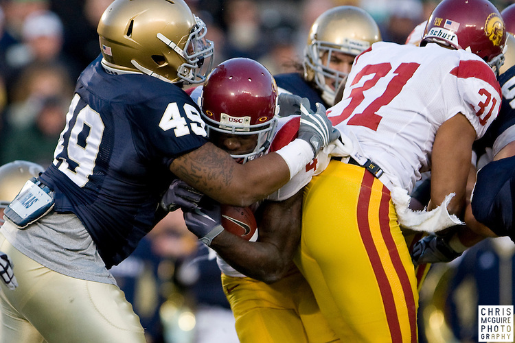 10/17/09 - South Bend, IN:  USC running back Joe McKnight is stopped before reaching the end zone by Notre Dame linebacker Toryan Smith during their game at Notre Dame Stadium on Saturday.  USC won the game 34-27 to extend its win streak over Notre Dame to 8 games.  Photo by Christopher McGuire.