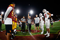 LOS ANGELES, CA - SEPTEMBER 7: Captains of the USC Trojans and the Stanford Cardinal meet for the coin toss during a game between USC and Stanford Football at Los Angeles Memorial Coliseum on September 7, 2019 in Los Angeles, California.