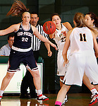 JANUARY 24, 2015 -- Chelsey Biegler #22 of Black Hills State passes to teammate Taylor Trohkimoinen #11 after running into CSU-Pueblo defenders during their Rocky Mountain Athletic Conference women's basketball game at the Donald E. Young Center in Spearfish, S.D. Saturday. At left is Angie Moore #20 of CSU-Pueblo.  (Photo by Dick Carlson/Inertia)