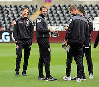 (L-R) Dan Gosling and Glenn Murray of Bournemouth share a joke with team mates on the pitch before the Barclays Premier League match between Swansea City and Bournemouth at the Liberty Stadium, Swansea on November 21 2015