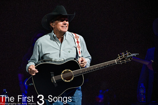 George Strait performs on stage during the Cowboy Rides Away tour.