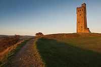 Victoria Tower on Castle Hill, a scheduled ancient monument in Almondbury overlooking Huddersfield in the Metropolitan Borough of Kirklees, West Yorkshire, England. <br /> <br /> The grade II listed Victoria Tower on the summit of Castle Hill is by far the most conspicuous landmark in Huddersfield. The hill has been a place of recreation for hundreds of years and the easily discernible remains of past occupation have made it a subject for legend, speculation and scientific study