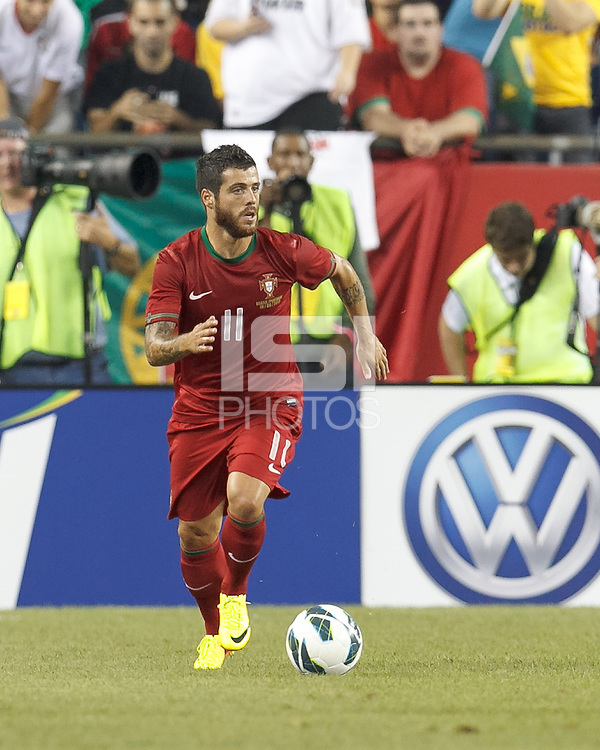 Portugal forward Vieirinha (11) brings the ball forward.  In an international friendly, Brazil (yellow/blue) defeated Portugal (red), 3-1, at Gillette Stadium on September 10, 2013.