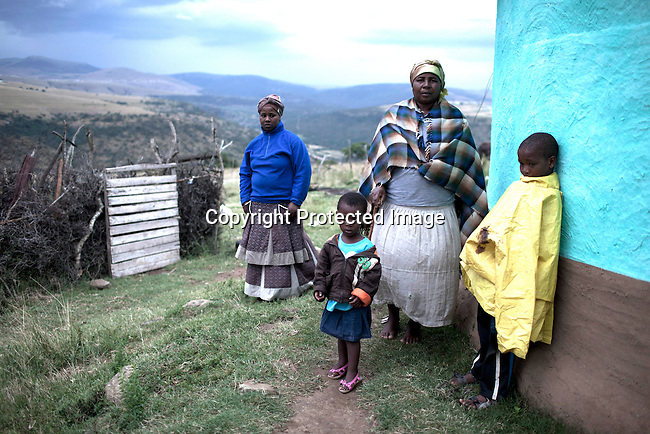 MVEZO, SOUTH AFRICA - MARCH 28: A family outside heir house on March 28, 2012 in Mvezo South Africa. Nelson Mandela was born in this rural village in 1918 and moved to nearby Qunu as a young boy. Qunu is about 32 kilometers away. The village is now headed by his grandson Mandla Mandela. (Photo by Per-Anders Pettersson)