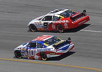May 6, 2007; Richmond, VA, USA; Nascar Nextel Cup Series driver Kasey Kahne (9) races alongside teammate Scott Riggs (10) during the Jim Stewart 400 at Richmond International Raceway. Mandatory Credit: Mark J. Rebilas
