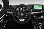 Car pictures of steering wheel view of a 2017 BMW 3-Series 330i 4 Door Sedan Steering Wheel