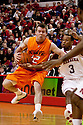 12 February 2011: Oklahoma State Cowboys guard Keiton Page #12 carries the ball while being guarded by Nebraska Cornhuskers guard Brandon Richardson #3 during the second half at the Devaney Sports Center in Lincoln, Nebraska. Nebraska defeated Oklahoma State 65 to 54.