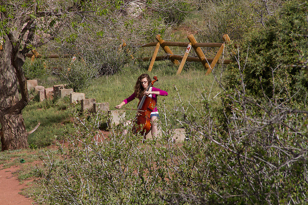 Young woman cellist in Red Rocks State Park, Colorado .  John leads private photo tours in Boulder and throughout Colorado. Year-round. .  John offers private photo tours in Denver, Boulder and throughout Colorado. Year-round.