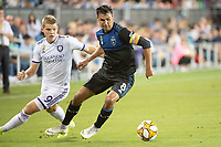 SAN JOSE,  - SEPTEMBER 1: Chris Wondolowski #8 of the San Jose Earthquakes evades Chris Mueller #9 of the Orlando City SC during a game between Orlando City SC and San Jose Earthquakes at Avaya Stadium on September 1, 2019 in San Jose, .